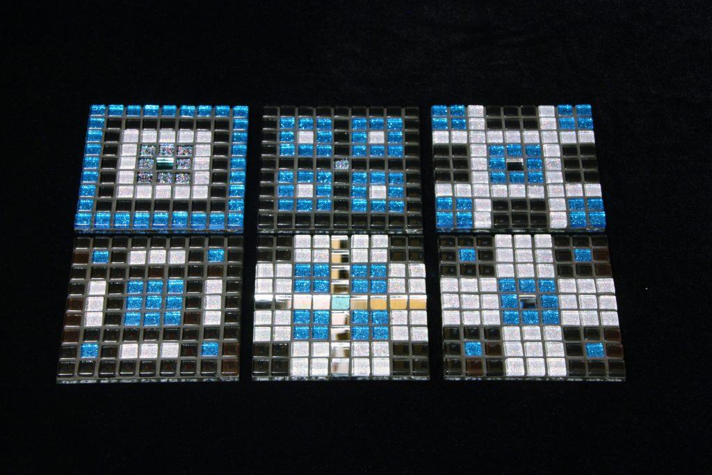 Set of six blue, black and white mosaic coasters commission